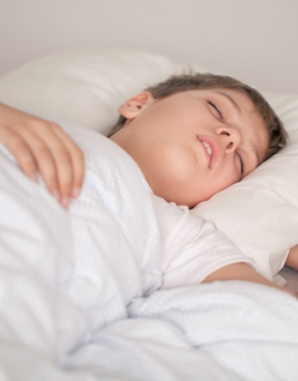 http://www.dreamstime.com/stock-photography-adorable-boy-sleeping-white-pajamas-image18919192