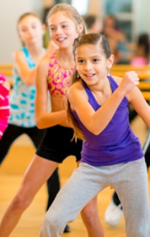 Group of children participating in dance fitness class.