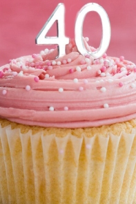Mini fortieth birthday cake decorated with a single candle