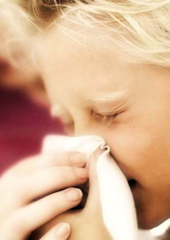 Boy Blowing His Nose into a Handkerchief --- Image by © Royalty-Free/Corbis